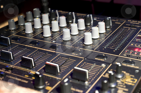 Turntable faders stock photo, Buttons, levers and switches on the control panel of a turntable by Corepics VOF