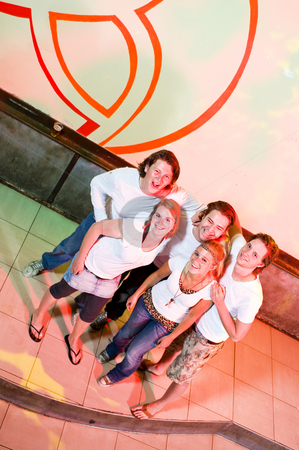 Friends stock photo, Group of five young adults on the dance floor in a nightclub by Corepics VOF