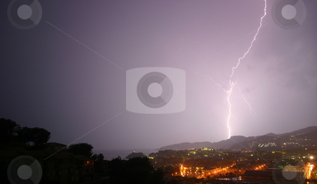 Lightning 3 of 3 stock photo, 3 lightning photos shot from the same viewpoint.  Same landscape, choice of bolts.  The image is taken from a high viewpoint, overlooking trees, a town and mountains. by Darren Booth