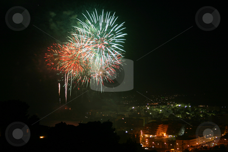 Fireworks 1 of 4 stock photo, Fireworks at a seaside Spanish fiesta taken from a high viewpoint and overlooking a town.  Same view 4 times with a choice of firework airbursts. by Darren Booth