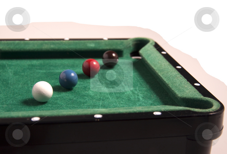 Billiard stock photo, A little toy pool with balls of different colors by Fabio Alcini