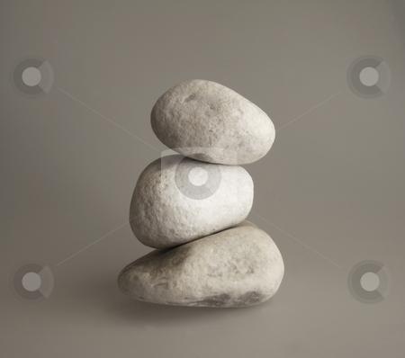 Stones stock photo, Three pebbles in a pile by Fabio Alcini