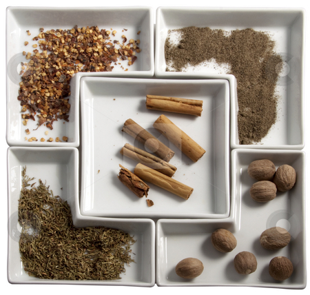 Spices stock photo, Five kind of spices over white plates by Fabio Alcini