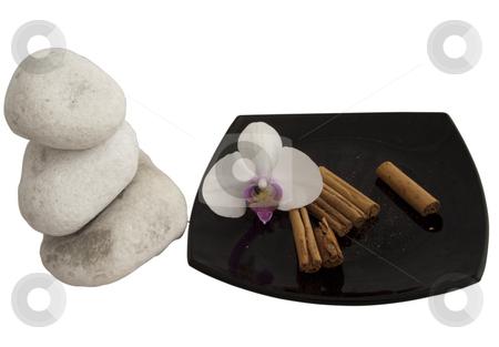 Cinnamon stock photo, Pieces of cinnamon on a black plate by Fabio Alcini