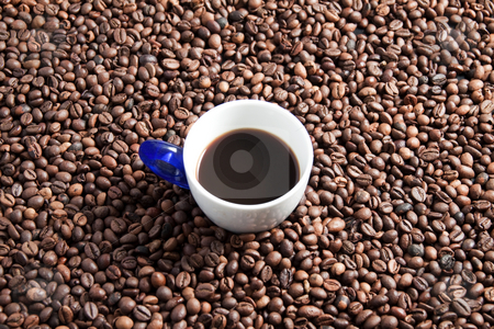 Coffee stock photo, A cup full of coffee surrounded by coffee beans by Fabio Alcini
