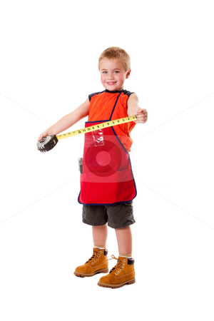 Boy with measuring tape stock photo, A Caucasian male young child dressed in an orange apron and construction boots holding yellow measuring tape, isolated. by Paul Hakimata
