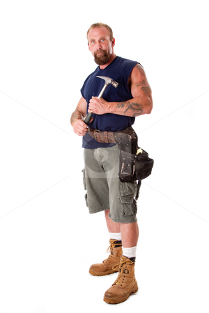 Man with hammer stock photo, Big Caucasian guy with tattoos standing with hammer in his hands and wearing a tool belt, isolated. by Paul Hakimata