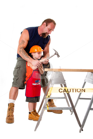 Father teaching son construction stock photo, Caucasian father teaching his cute son how to hild a hammer and hit a nail into a wooden plank, isolated. by Paul Hakimata