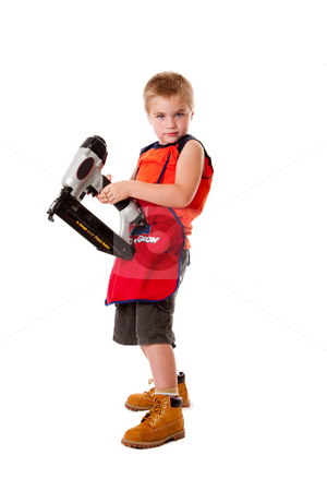 Cute boy with nail gun stock photo, Cute kid with orange apron and yellow boots holding a heavy duty nail gun, isolated. by Paul Hakimata