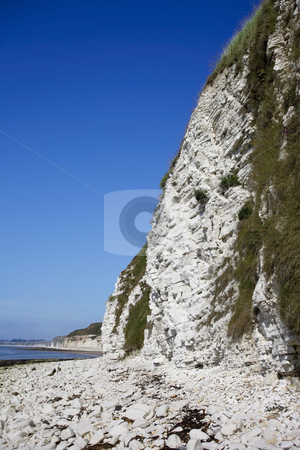 Limestone sea cliffs stock photo, View of limestone sea cliffs under a warm blue summer sky by Mike Smith