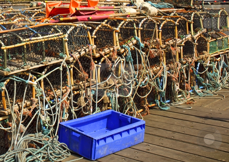 Lobster pots stock photo, A selection of lobster pots on a harbour in summer by Mike Smith