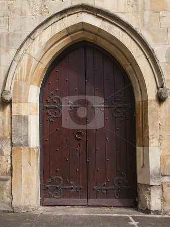 Mediaeval doorway stock photo, A mediaeval church doorway with oak door and wrought iron fittings by Mike Smith