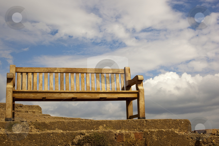 Cliff top seat 2 stock photo, A traditional wooden bench on a cliff top view point under a dramatic summer sky by Mike Smith