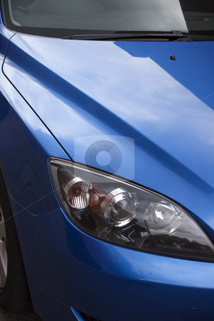 Modern blue car stock photo, A contemporary blue car with reflections by Mike Smith