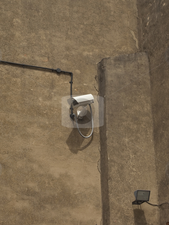 Security camera and light on old wall stock photo, A modren security camera and light on an old rendered wall by Mike Smith