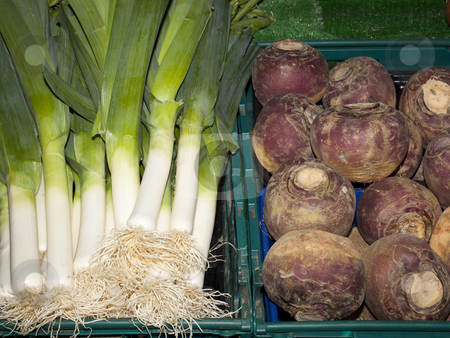 Fresh leeks and swedes ready for sale stock photo, Fresh leeks and swedes ready for sale on a market stall by Mike Smith