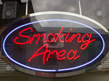 Neon smoking area sign stock photo, Bright neon smoking area sign in city street by Mike Smith