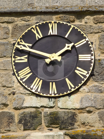 A black and gold clock stock photo, A black and gold clock on a church tower by Mike Smith