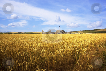 A potash mine with wheat fields stock photo, A potash mine with golden wheat fields under a blue summer sky by Mike Smith