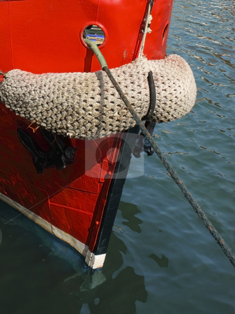Bow of a fishing boat stock photo, A bow of a fishing boat in a harbour in summer by Mike Smith