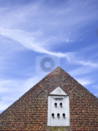 Eighteenth century architecture stock photo, The gable end of an eighteenth century building with ornamental brickwork and dovecote by Mike Smith