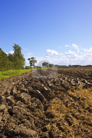 Ploughed soil stock photo, An image of ploughed soil in the countryside in summer by Mike Smith