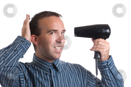 Vanity stock photo, Concept image of metrosexual male featuring a young male using a hair dryer to fix his hair nicely, isolated against a white background by Richard Nelson