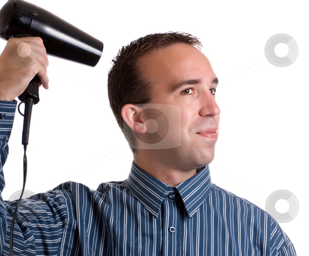 Male Primping stock photo, Concept image of metrosexual male featuring a young male using a hair dryer to fix his hair nicely, isolated against a white background by Richard Nelson