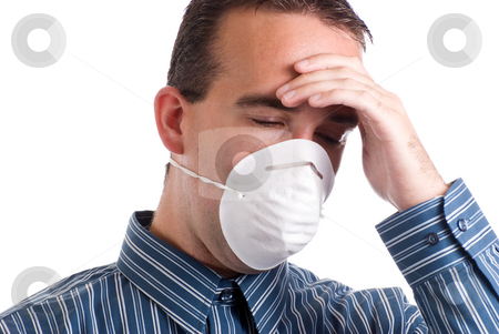 Respiratory Infection stock photo, A young man with a respiratory infection is wearing a mask to protect others and is suffering from a headache, isolated against a white background by Richard Nelson