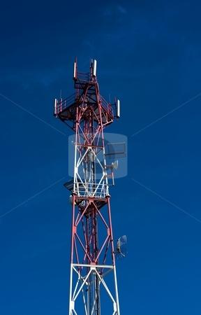 Detail of telecommunicatiopn tower stock photo, Detail of red white telecommunication tower on blue sky by Juraj Kovacik