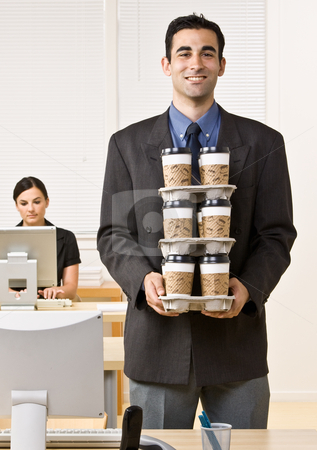 Businessman carrying tray of coffee stock photo, Businessman carrying tray of coffee by Jonathan Ross