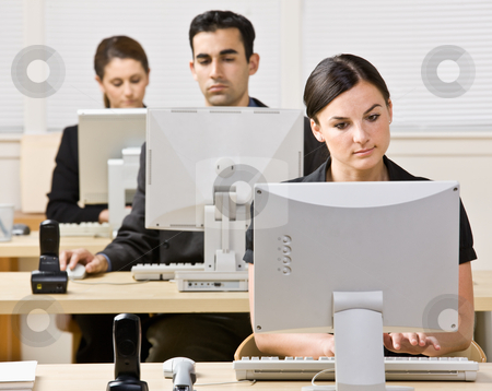 Business people working on computers stock photo, Business people working on computers by Jonathan Ross