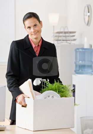Fired businesswoman carrying box stock photo, Fired businesswoman carrying box by Jonathan Ross