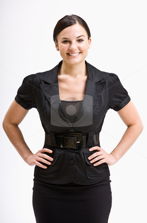 Smiling businesswoman with hands on hips stock photo, Smiling businesswoman with hands on hips by Jonathan Ross