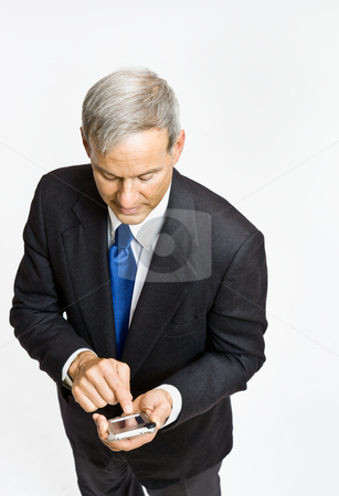 Businessman text messaging on cell phone stock photo, Businessman text messaging on cell phone by Jonathan Ross