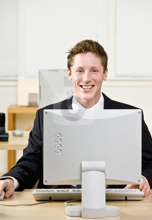 Businessman working on computer stock photo, Businessman working on computer by Jonathan Ross