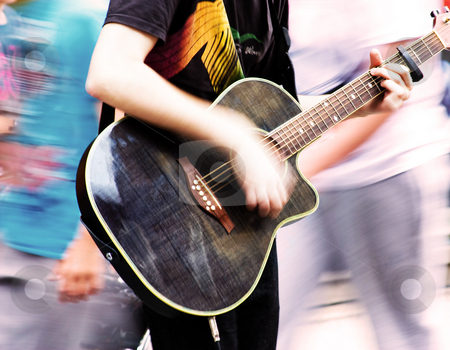 Young man playing guitar stock photo, Young man playing guitar. Motion blur. by Gabriele Mesaglio