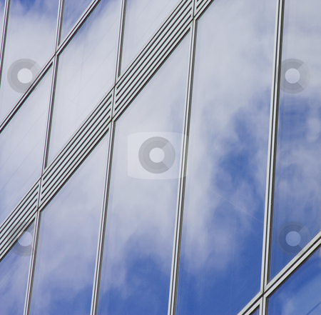 Sky and clouds reflection stock photo, Sky and clouds reflection on a building windows by Gabriele Mesaglio