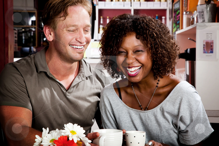 Mixed race couple in coffee house stock photo, Caucasian man and African American woman in coffee house by Scott Griessel