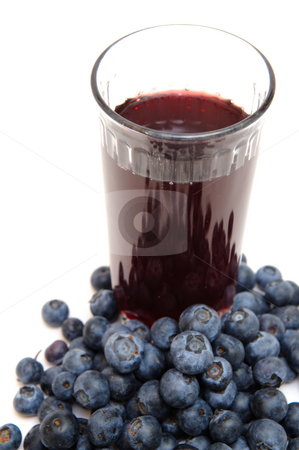 Healthy Blueberry Juice stock photo, Blueberries are a good source of antioxidants. a clear  glass with berry juice with berries all around on a white background. by Lynn Bendickson