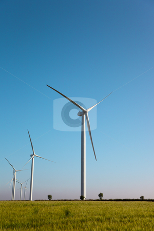 Wind turbines on hillside stock photo, Wind turbines on hillside on a bright summer day by Mike Smith