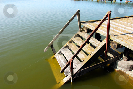 Wooden stairs into water stock photo, Old shabby wooden staircase on green Palic lake, Serbia by Julija Sapic