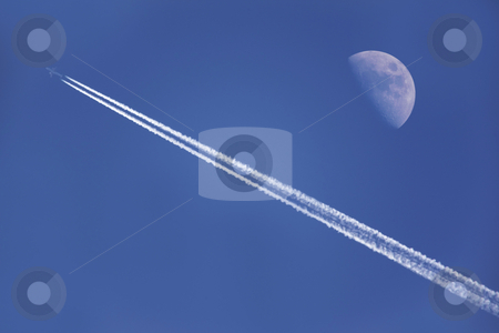 Flying with the moon stock photo, An airplane flying near the moon in the afternoon by Bernardo Varela