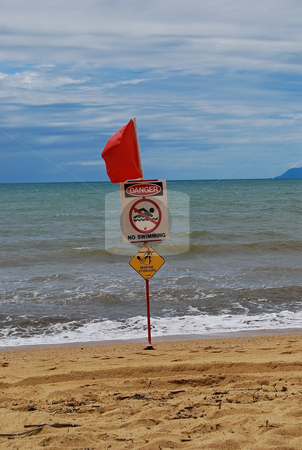 No swimming here stock photo, Australian no swimming flag on the beach by Emma White