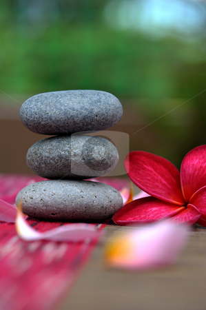 Spa stone  stock photo, Spa stone and red plumeria by Jaggat Images