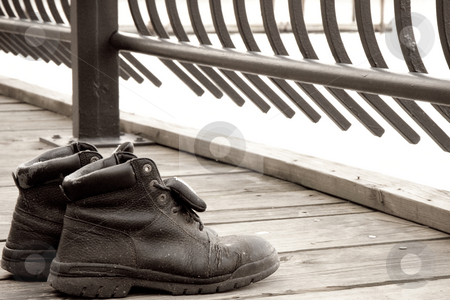 Old Shoes stock photo, Old shoes on a boardwalk along the Hudson River. by Tyson Koska