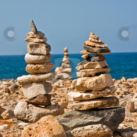 Rock Stacks stock photo, Stacks of rocks for luck, on a rocky beach. by Tyson Koska