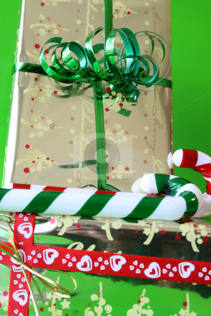 Gifts and Candy stock photo, Two gold wrapped gifts with red and green candy sticks by Vanessa Van Rensburg