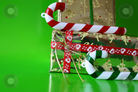 Candy and Gifts stock photo, Christmas decorations as candy canes and wrapped gifts by Vanessa Van Rensburg