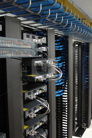 Data Center Racks stock photo, Communication racks holding routers and switches in a modern data center by Lee Torrens